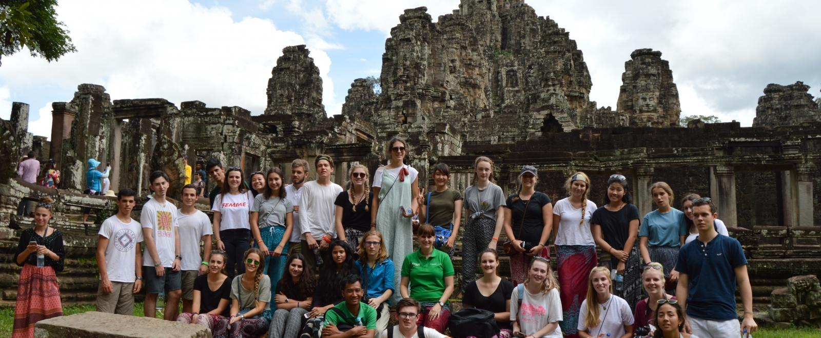 Projects Abroad staff take a group of school and college students on a temple tour during the weekend in Cambodia, Asia.